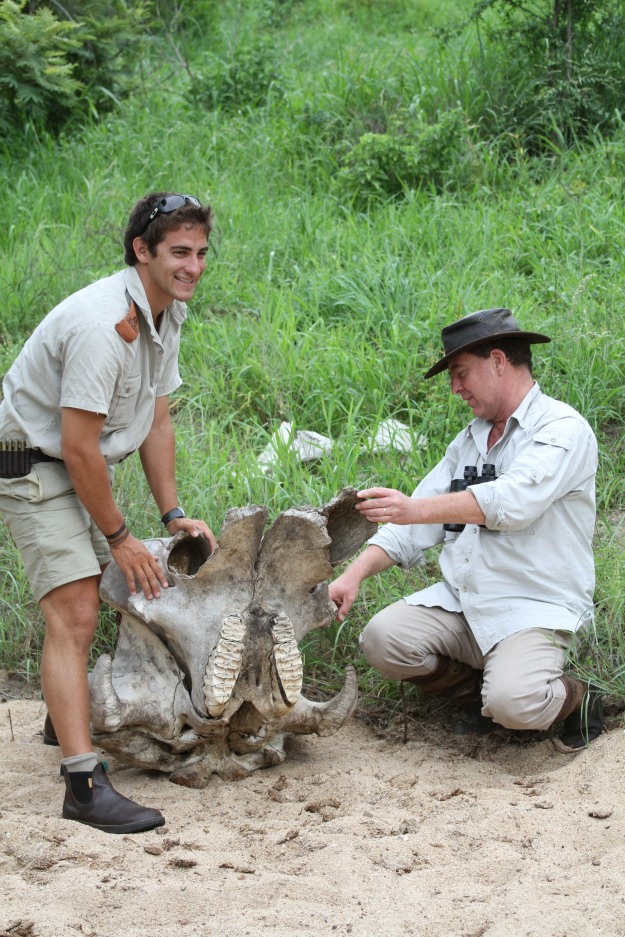 Dean and Hans taking a closer look at an elephant skull we discovered in a dry river bed.